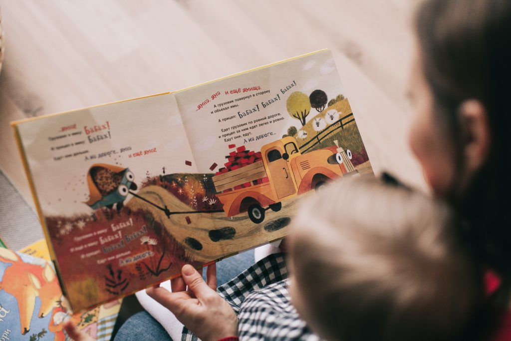 woman reading book to toddler 1741231