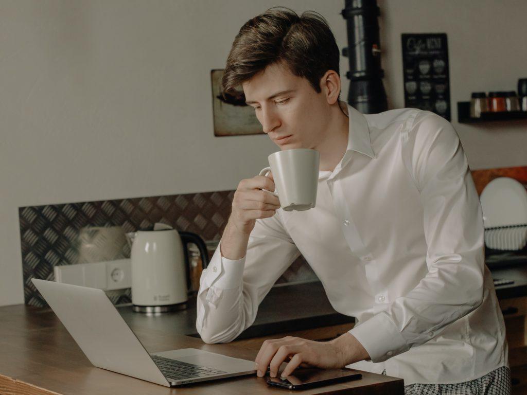 woman in white long sleeve shirt holding white ceramic mug 4114635